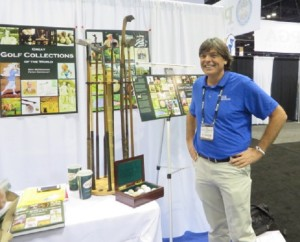 Happy Andy with golf books & clubs at the 2014 PGA Show!