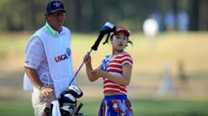 Lucy Li with caddie Byron Bush in the 2014 U.S. Women's Open at Pinehurst No. 2. Photo Credit: Google Images