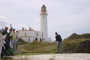 Tom Watson teeing off in front of the Lighthouse at Turnberry.